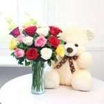 Arrangement of 15 Mix Roses with a 12 inch Teddy