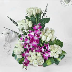 White Roses and Orchids in Cane Basket